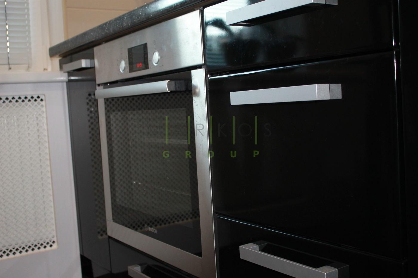 дизайн темной мебели для кухни изготовленной на заказ в Черкассах